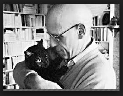 Michel Foucault con su gato.