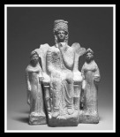 Enthroned goddess Artemis between two Attendants - Terracotta statuette, circa 4th c. BC.